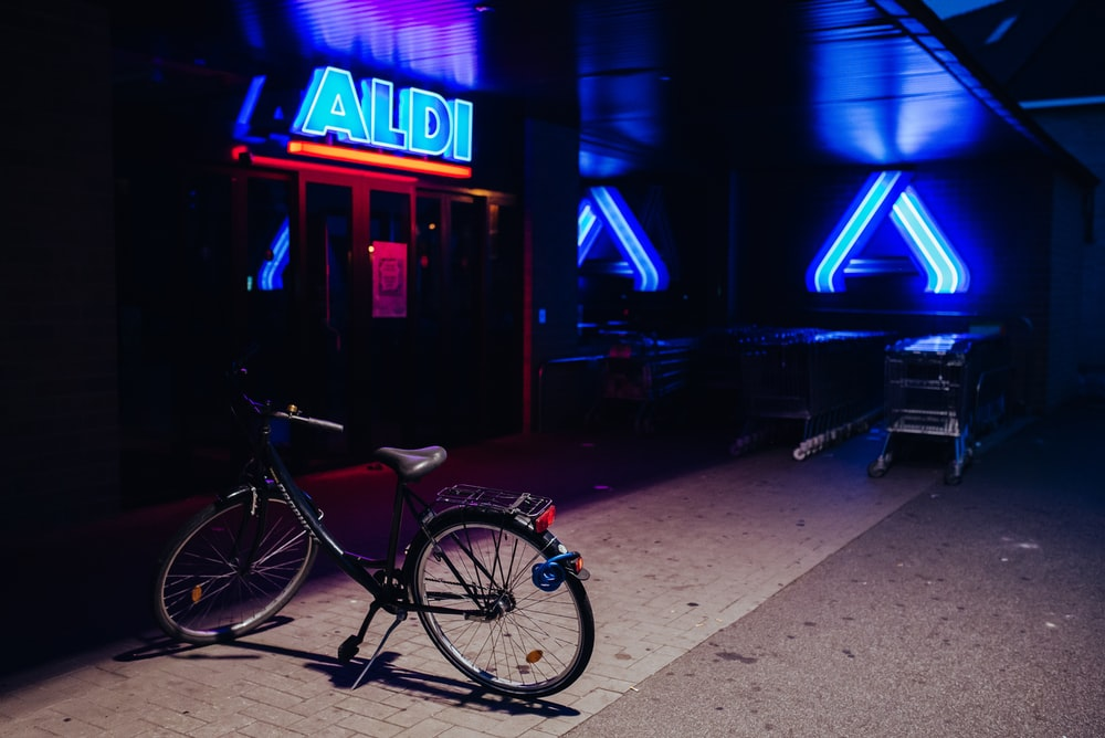 black bicycle parked beside store