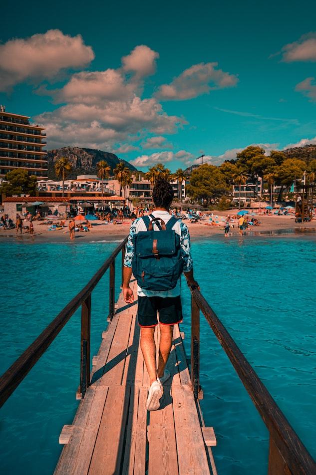 a man walks on a boardwalk in Majorca, Spain