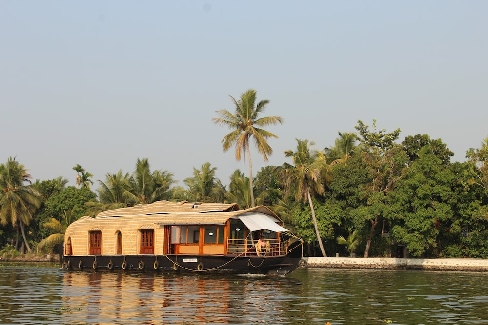 brown wooden house on body of water during daytime