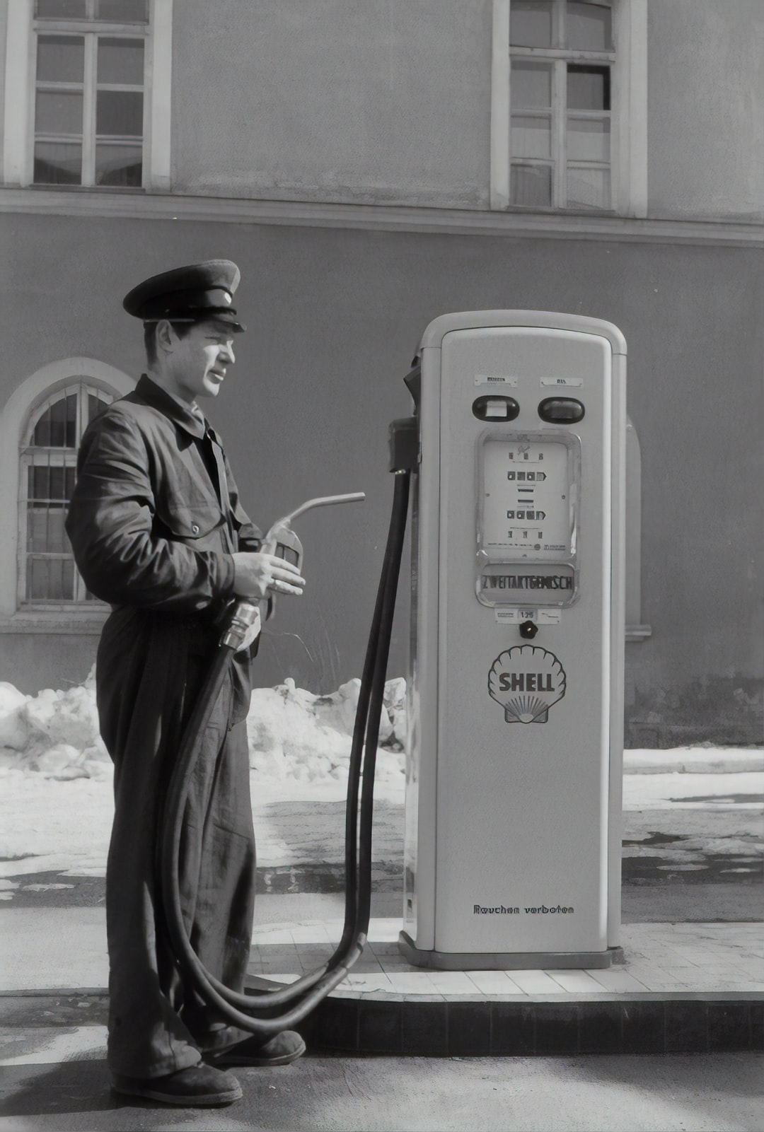 Gas station attendant at the petrol pump. 1955