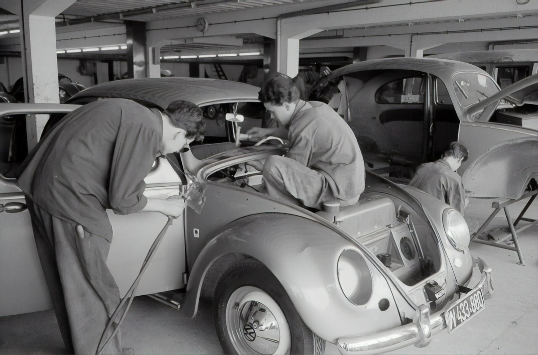 Workers on a VW Beetle. 1957