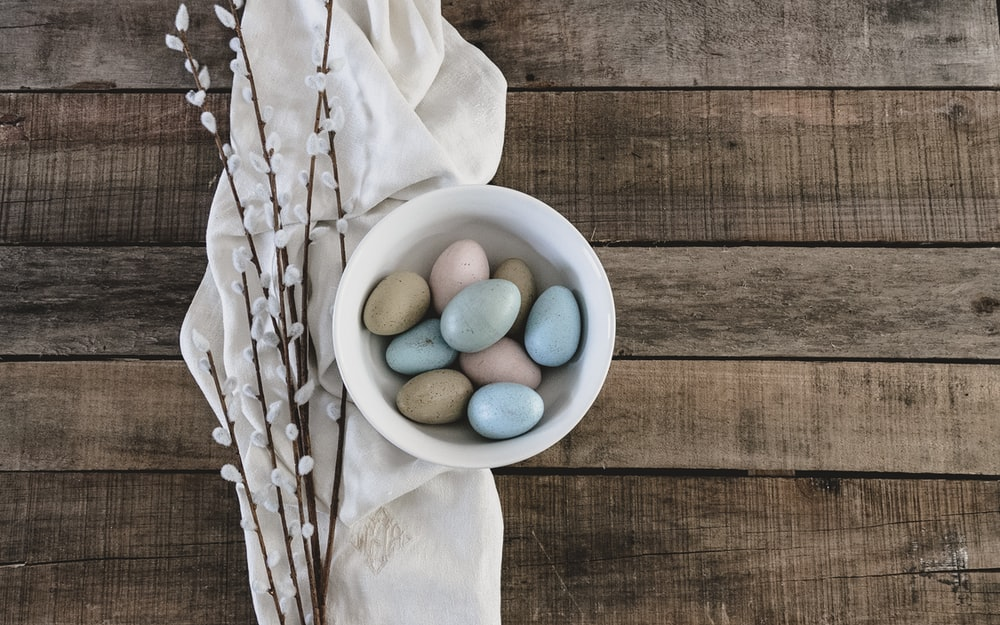 blue and green egg on white ceramic bowl