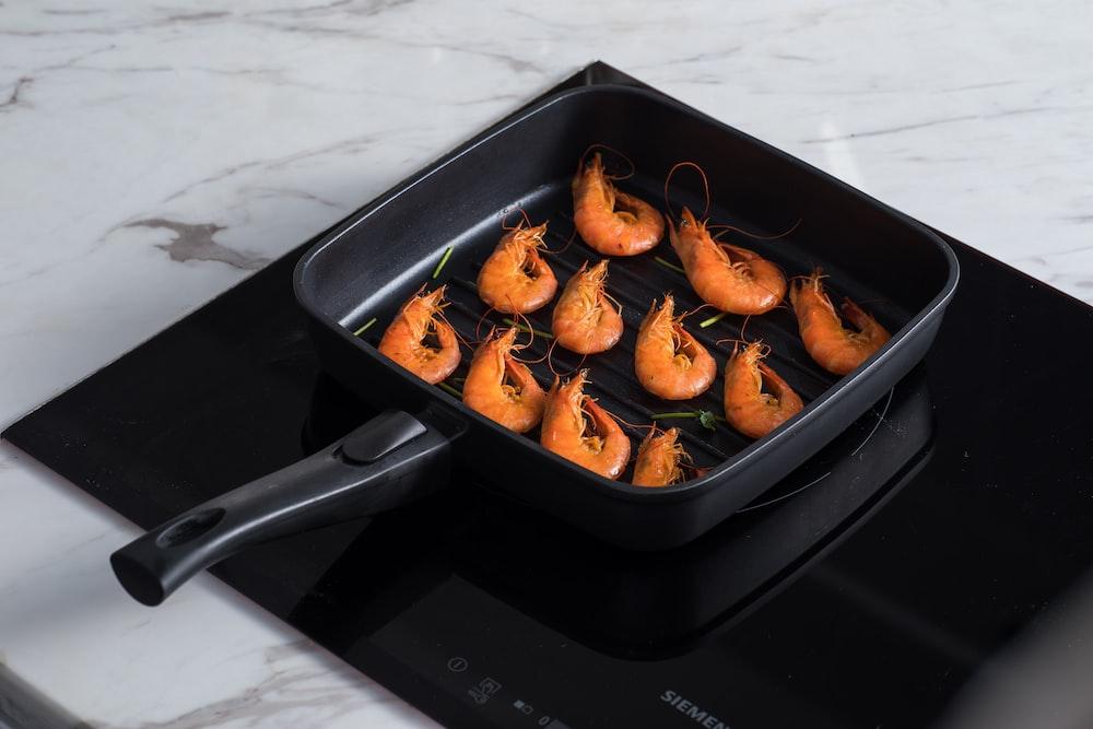 cooked food on black pan