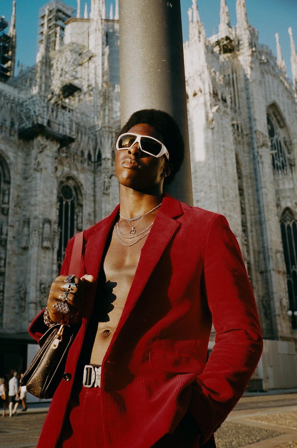 man in red suit jacket wearing black sunglasses