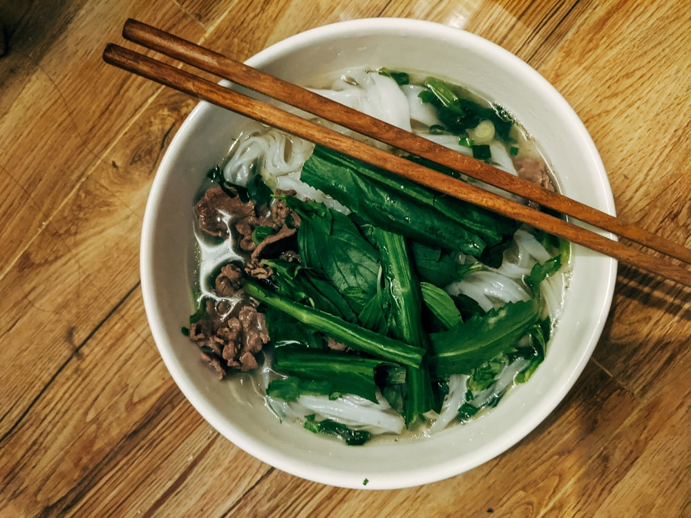 brown wooden chopsticks on white ceramic bowl