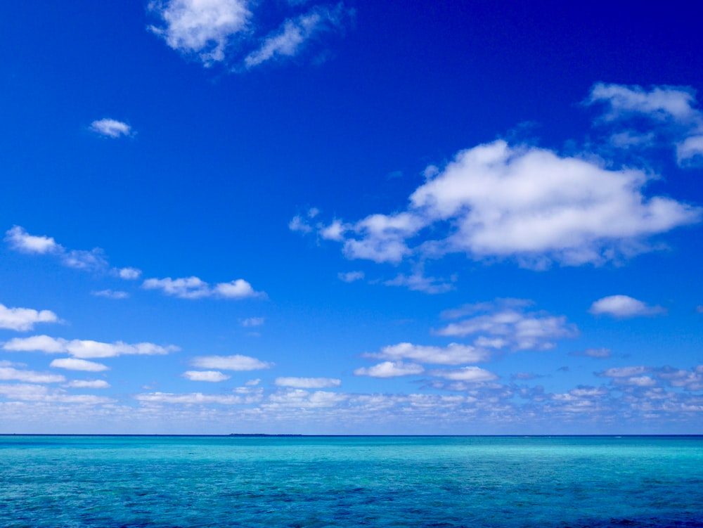 blue sky and white clouds over sea