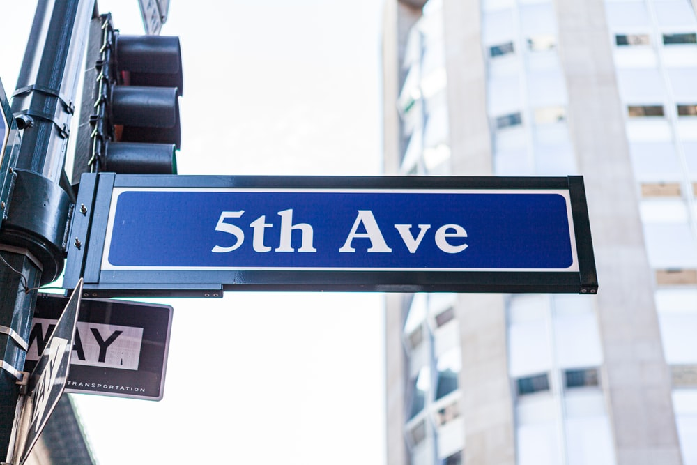 blue and white UNK street sign