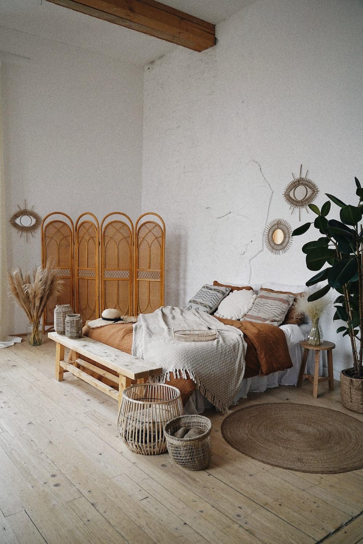 brown wooden door near brown woven armchair
