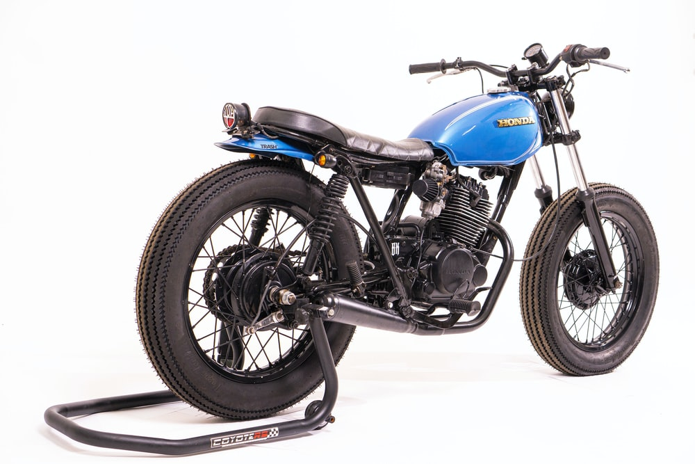 blue and black motorcycle on white surface