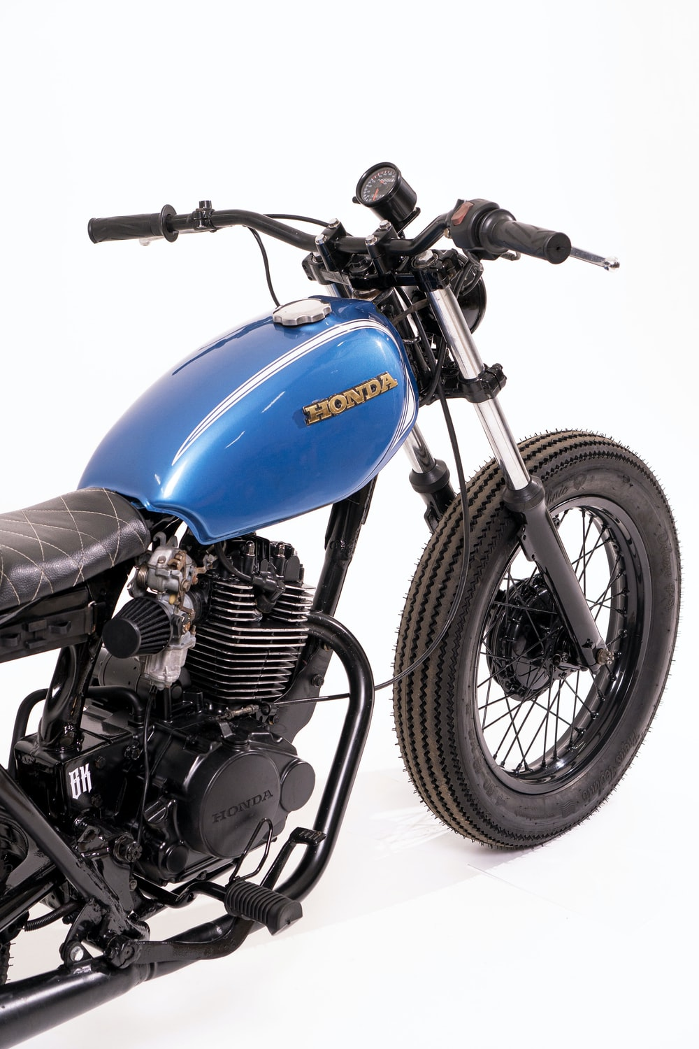 blue and black motorcycle with black tire