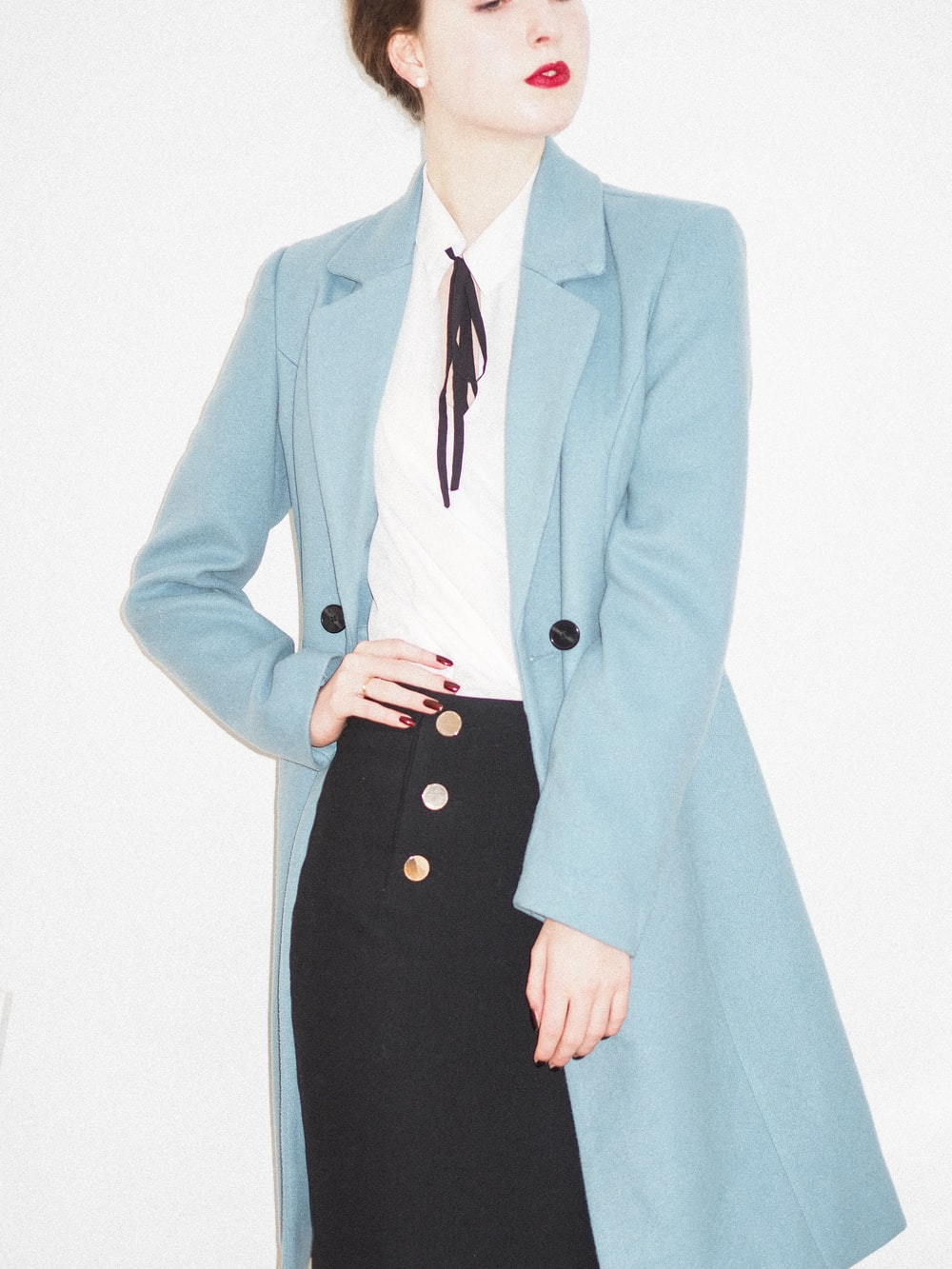 woman in teal blazer and black dress