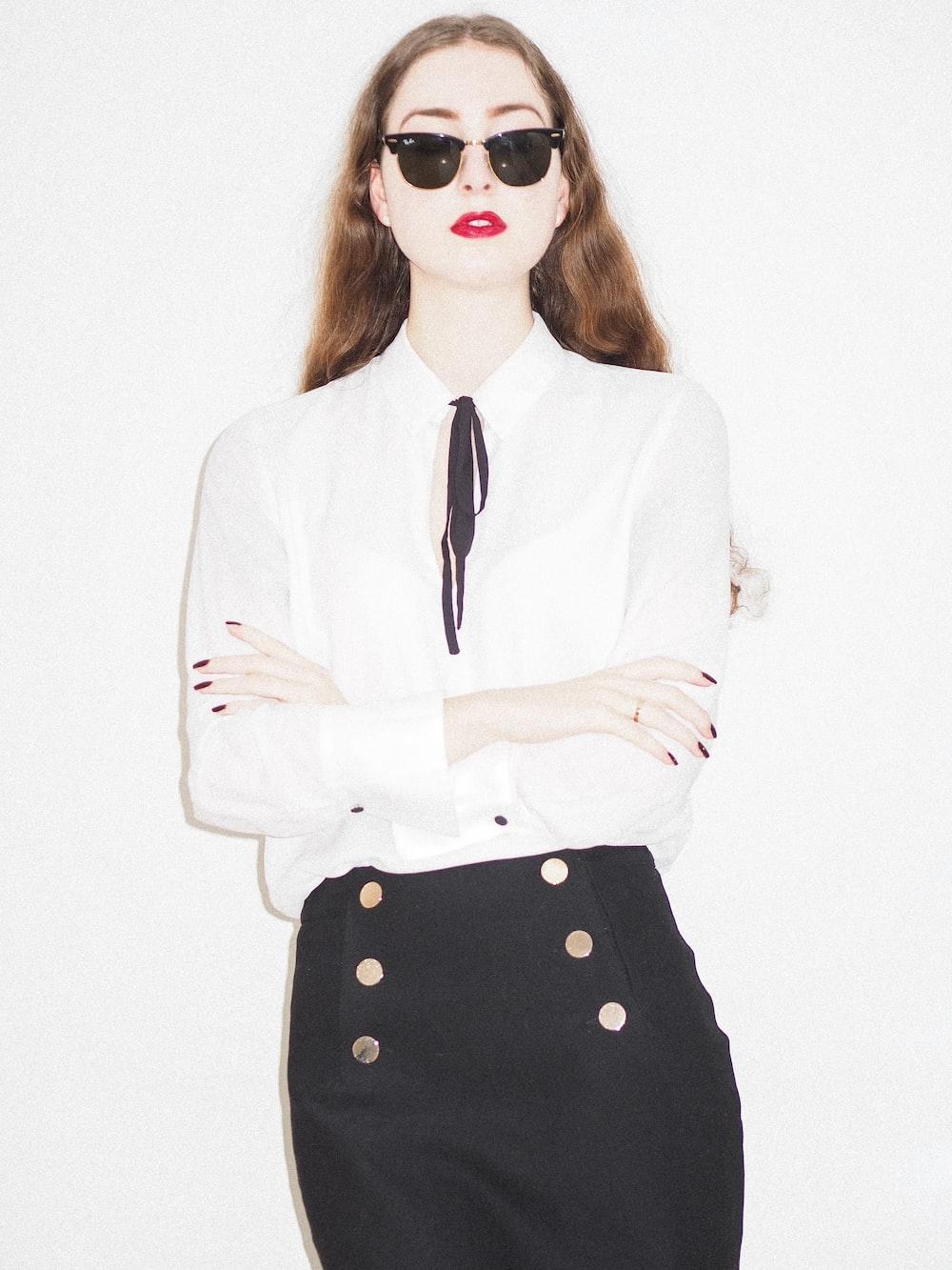 woman in white blazer wearing sunglasses