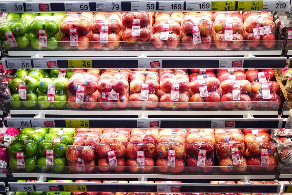 red and green apples in pack