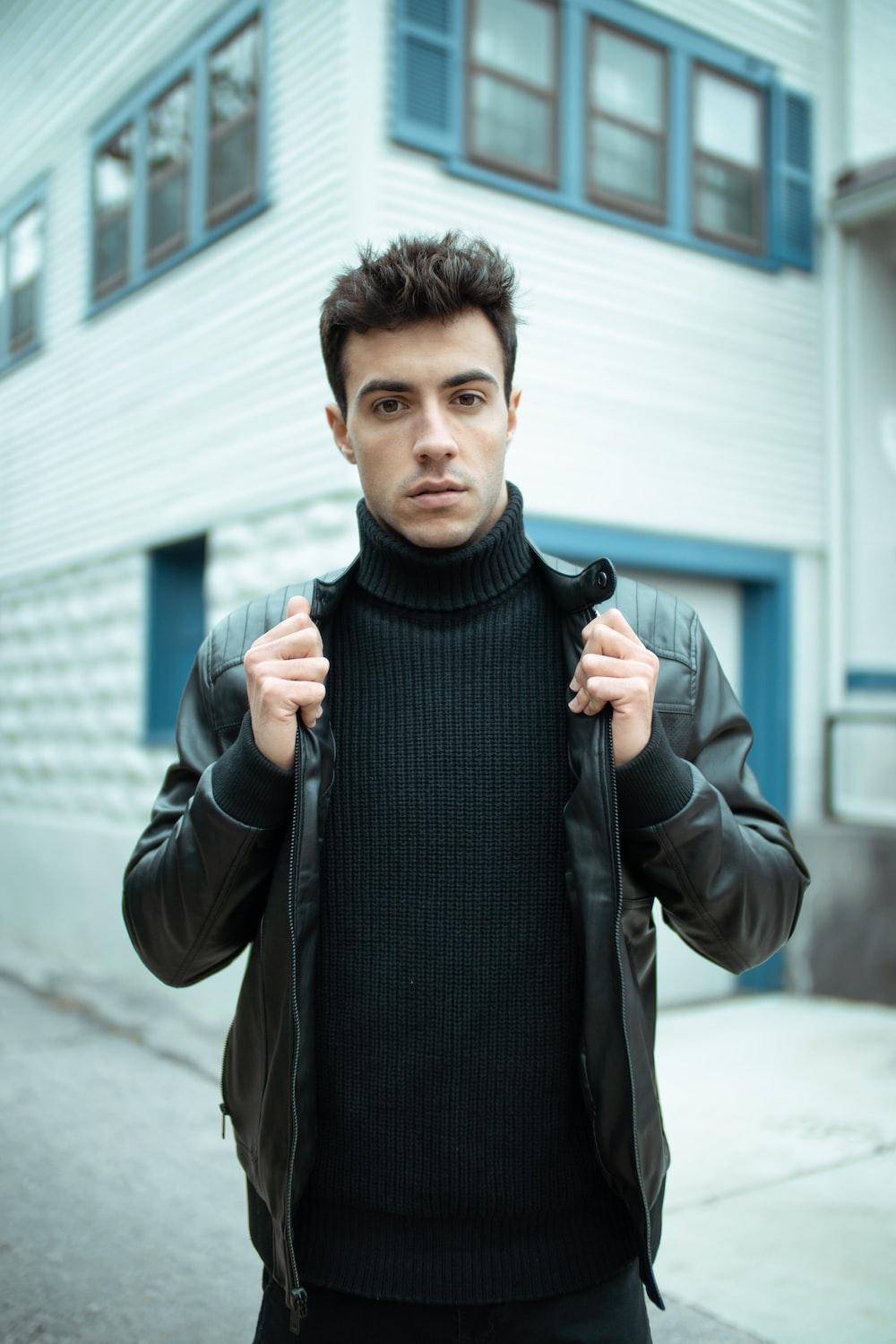 man in black turtleneck sweater and brown jacket