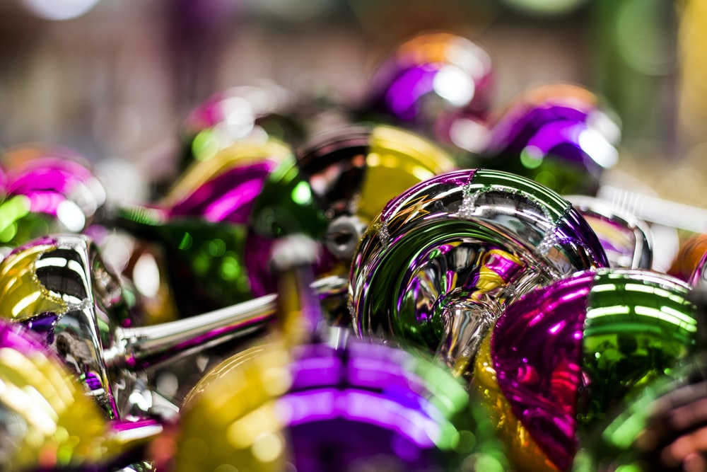 purple green and gold round ornament