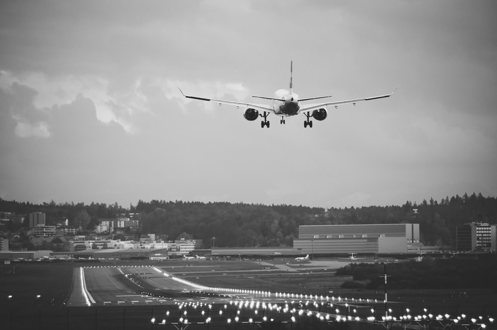 grayscale photo of airplane in the sky
