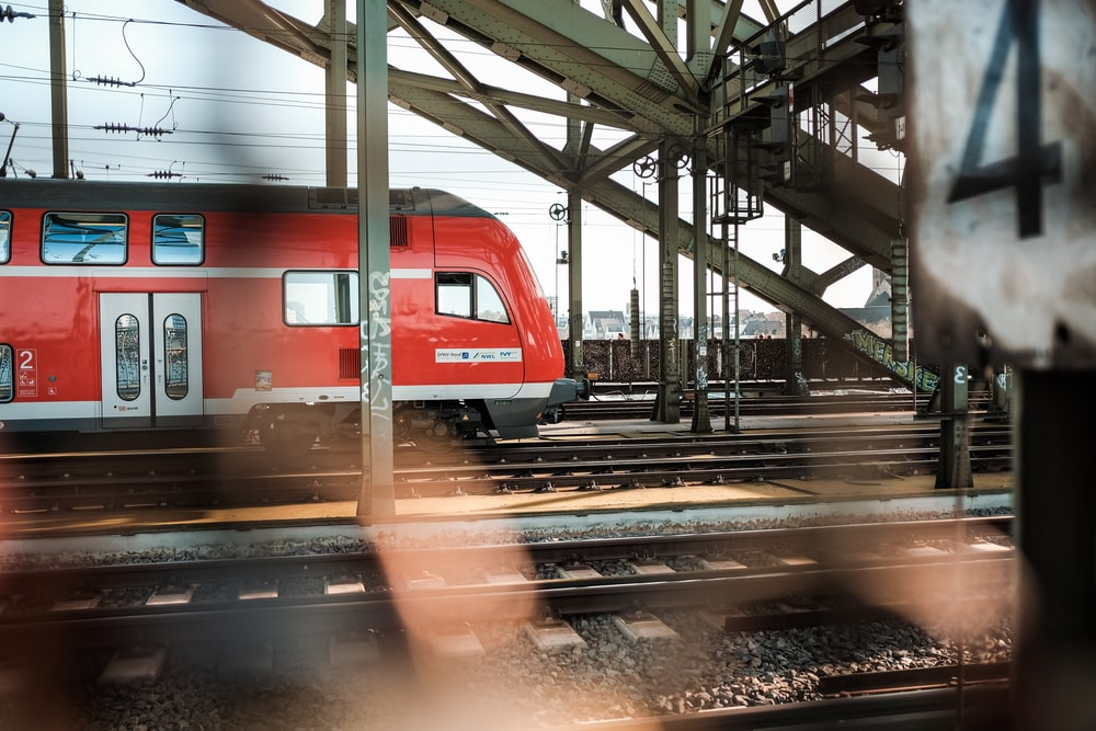 red and white train on train station