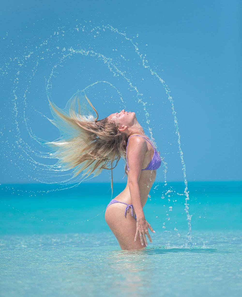 woman in blue bikini on water