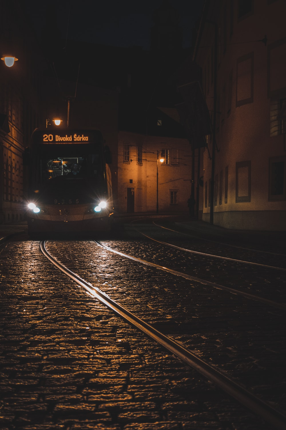black train in the middle of the street during night time