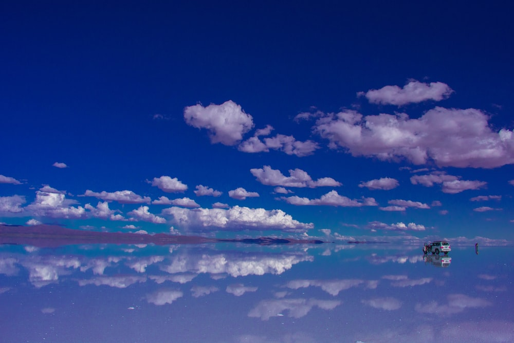 blue sky and white clouds over calm sea
