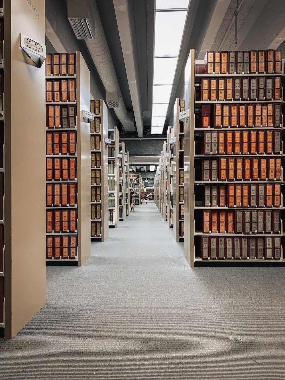 brown wooden book shelves on gray concrete floor
