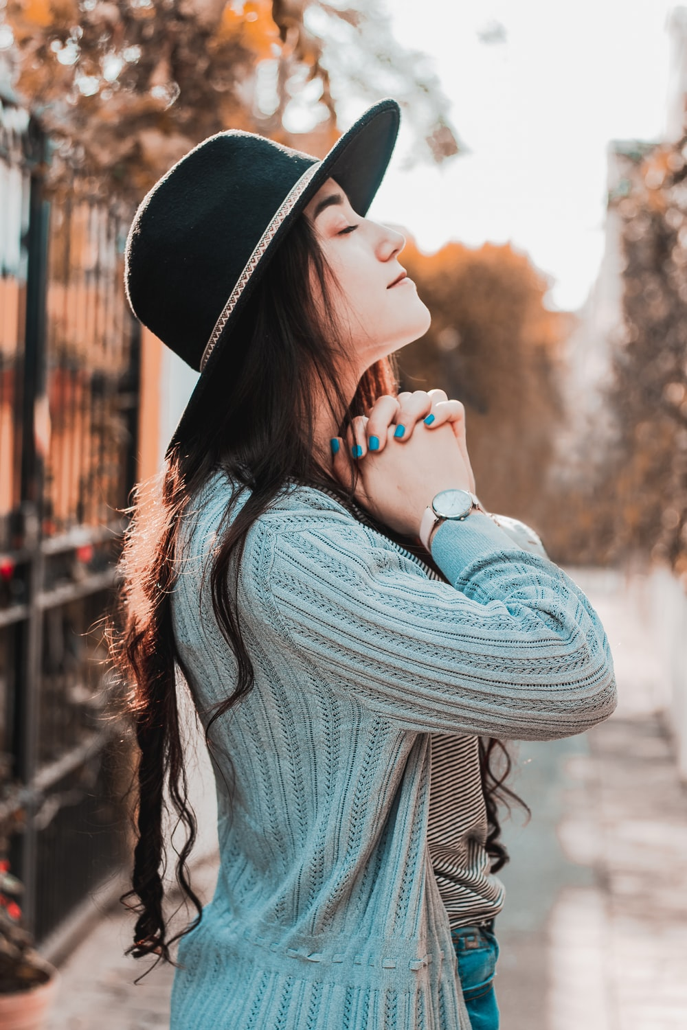 woman in black hat and gray sweater