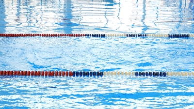 blue and white swimming pool swimming teams background