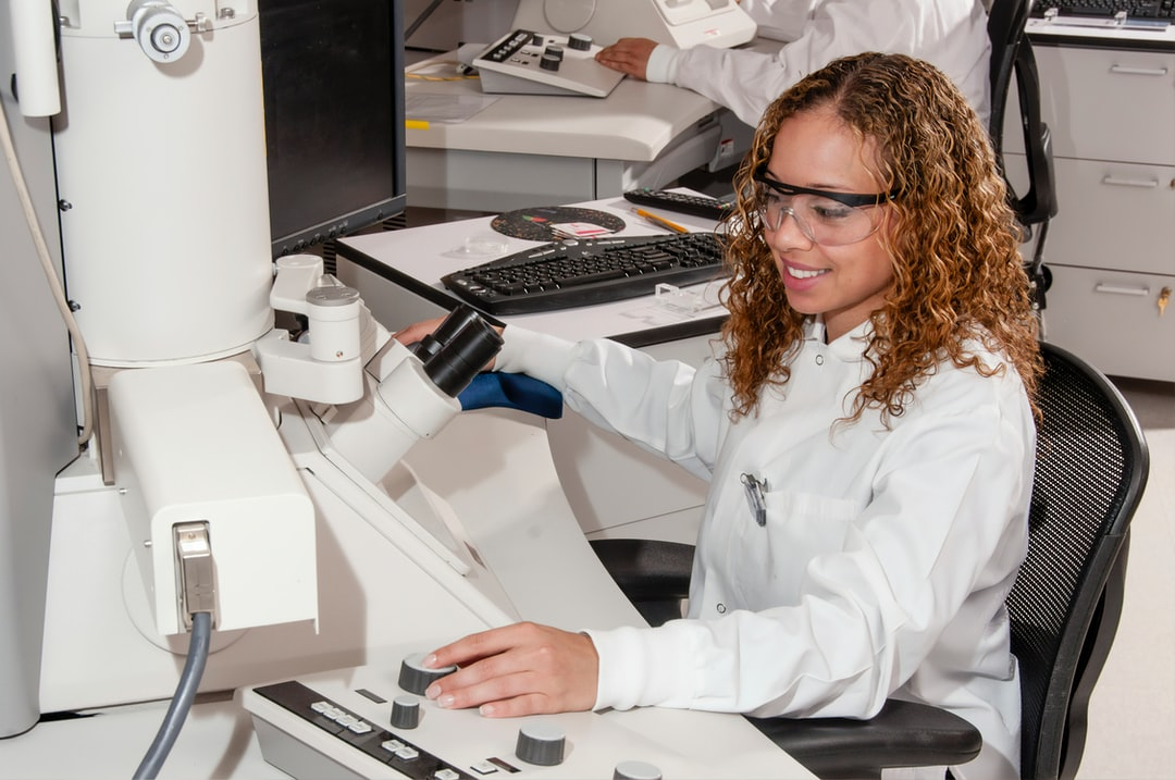 Technician works with an Electron Microscope in the Advanced Technology Research Facility (ATRF), Frederick National Laboratory for Cancer Research, National Cancer Institute.