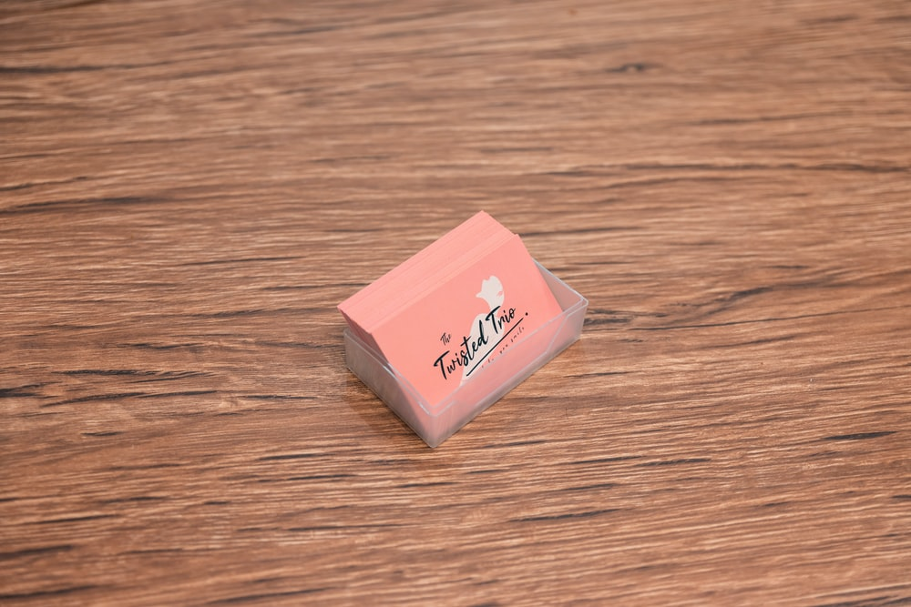 pink and white box on brown wooden table