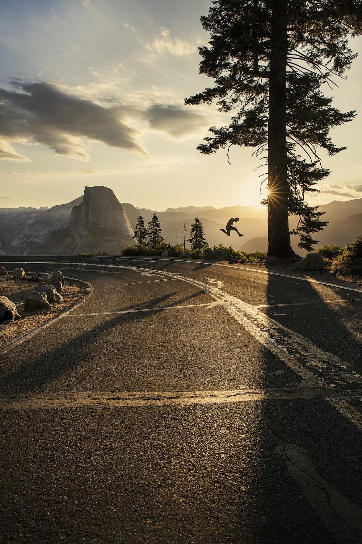 gray asphalt road near mountain during daytime