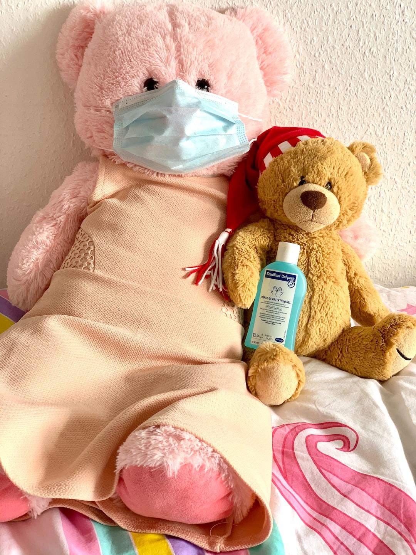Teddy bear wearing a mask Teddy bear holding handrubs