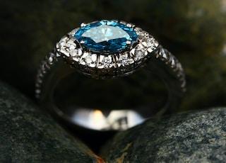 silver diamond ring on gray stone