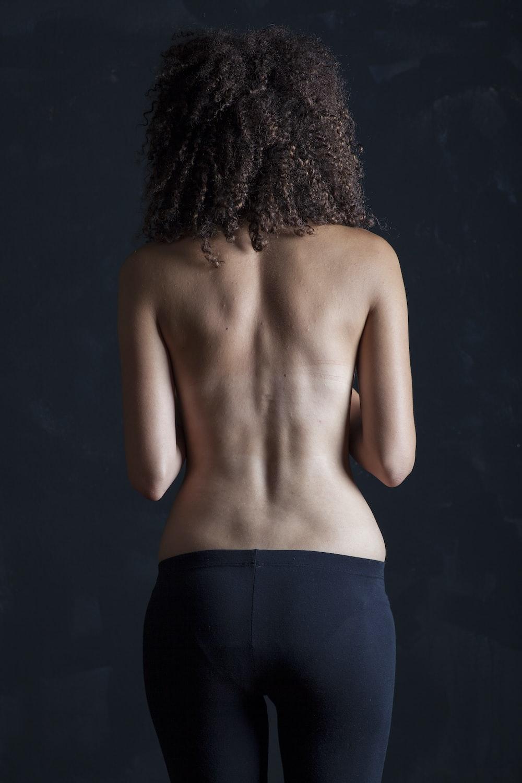 topless woman in black skirt
