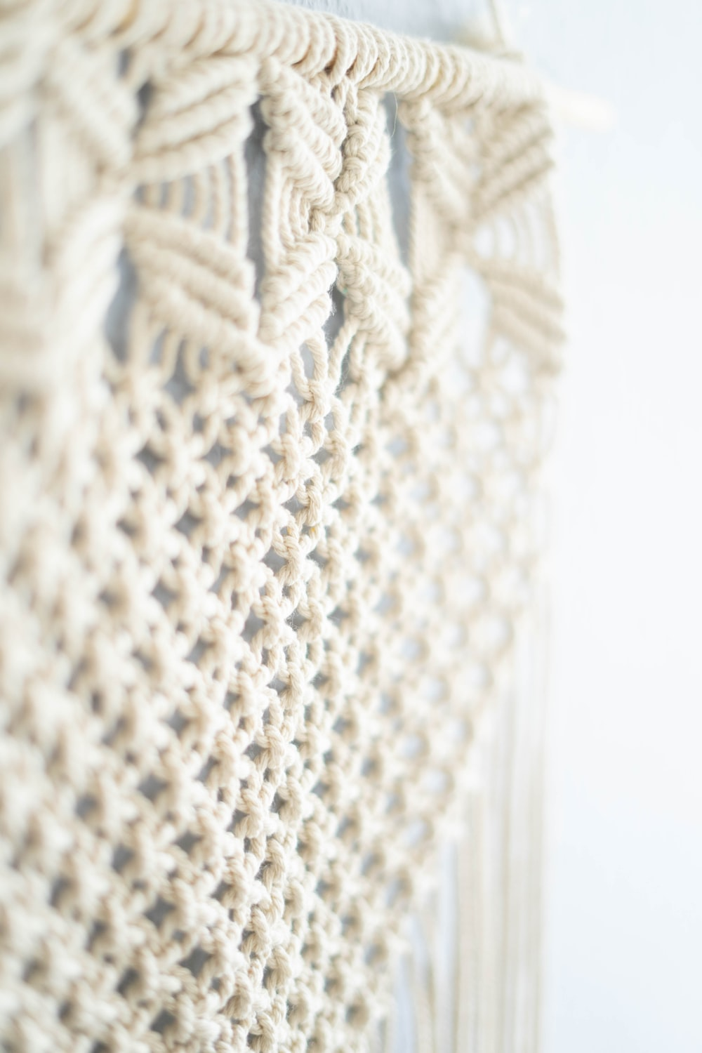 white knit textile in close up photography