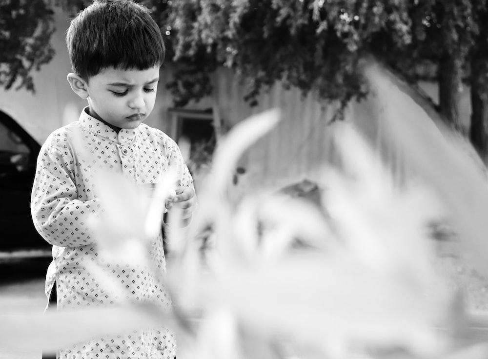 grayscale photo of girl in polka dot dress