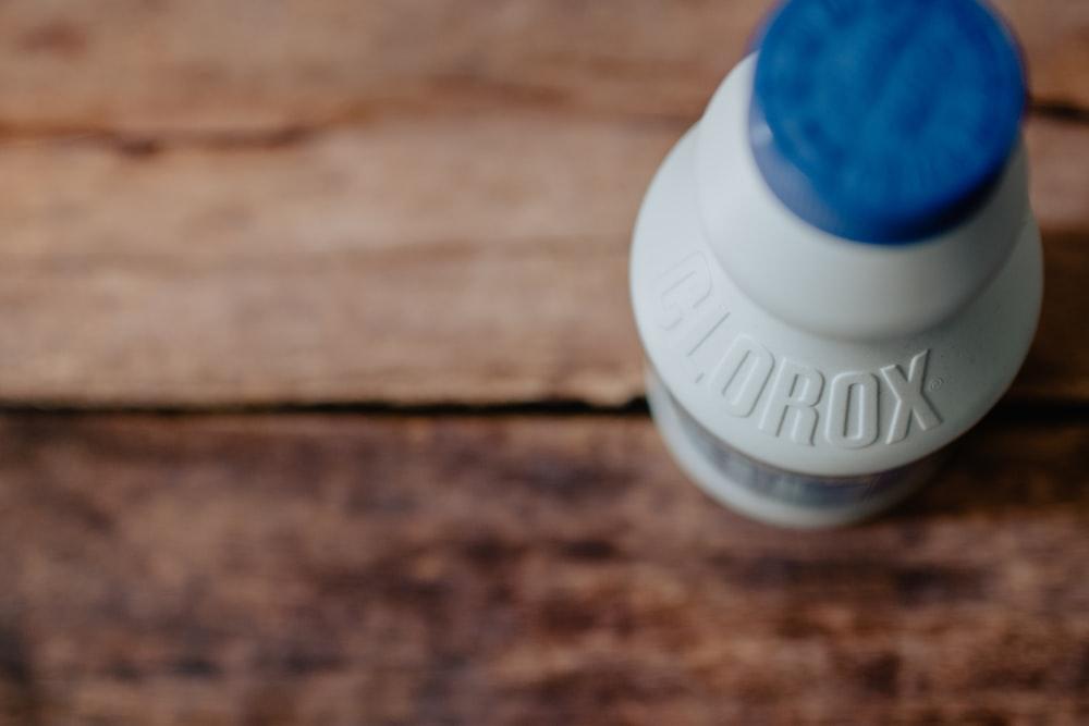 white and blue plastic bottle
