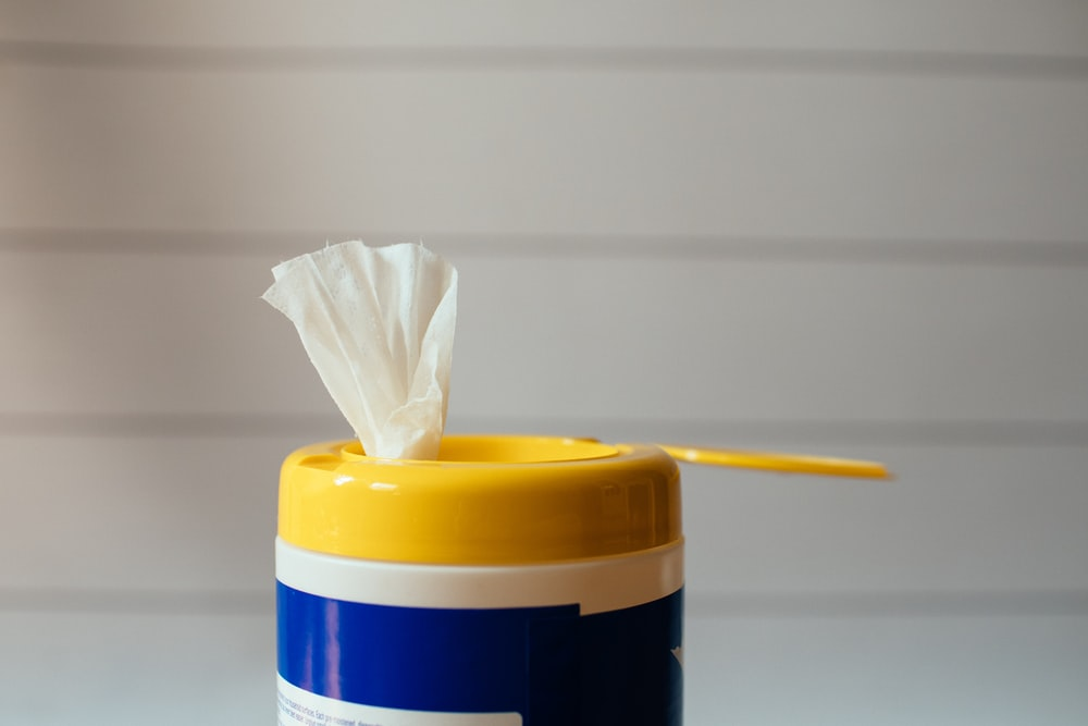 yellow pencil on white and blue plastic container