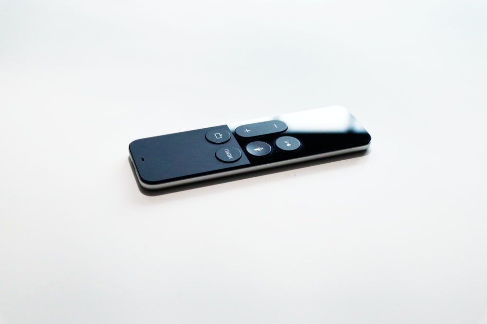black remote control on white surface