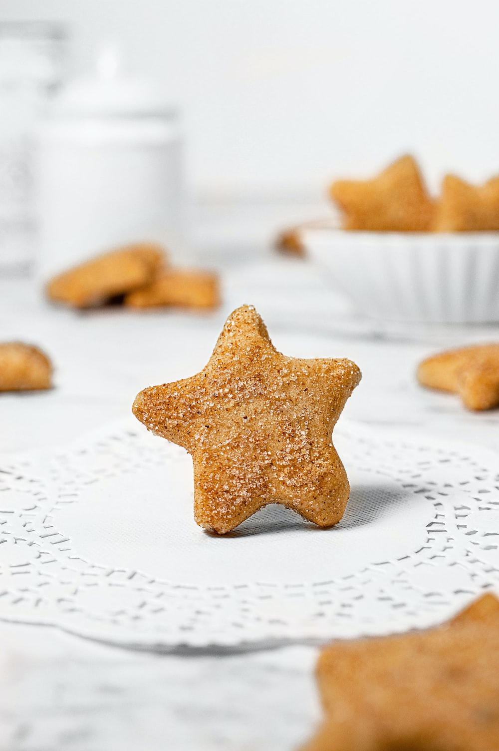 brown star shaped cookie on white table