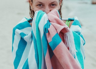 woman covering her body with white and blue blanket