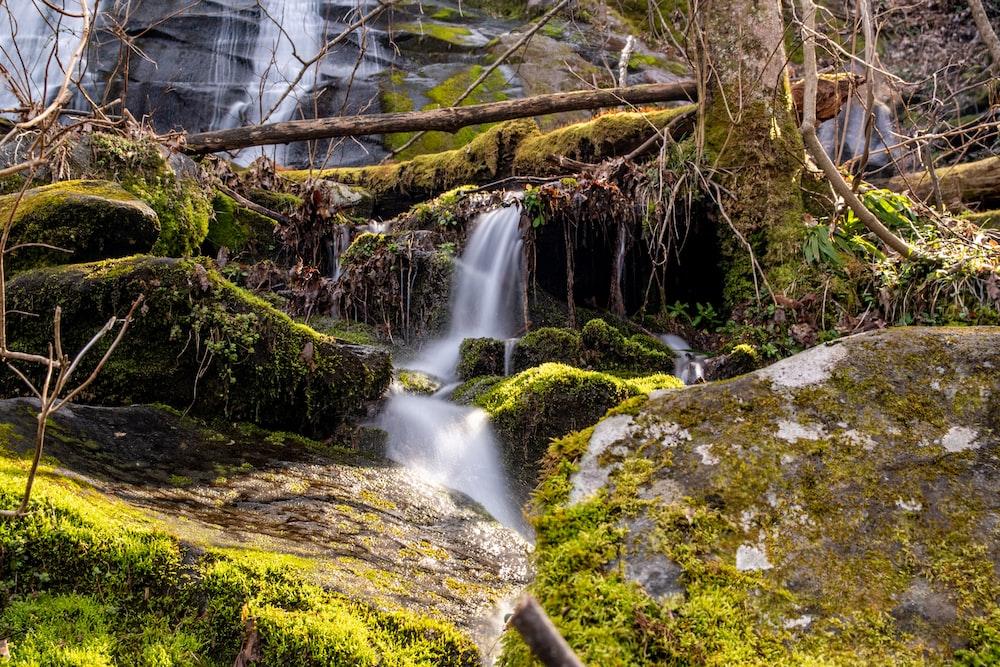 water falls on gray rock