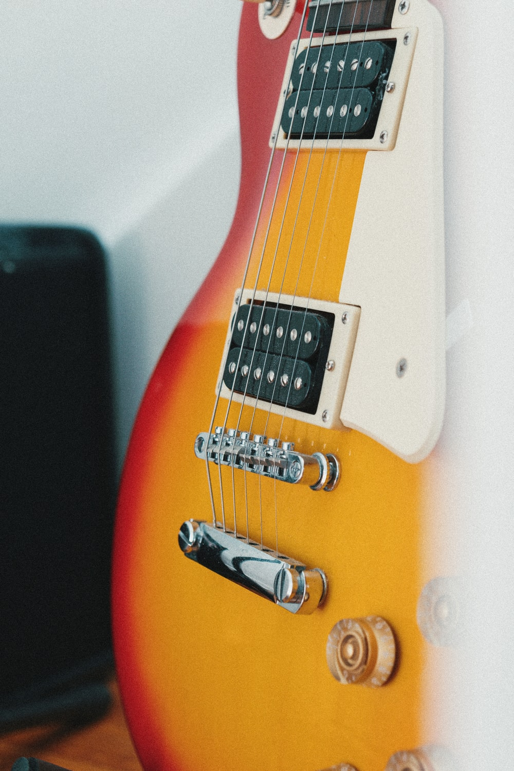 orange and white electric guitar