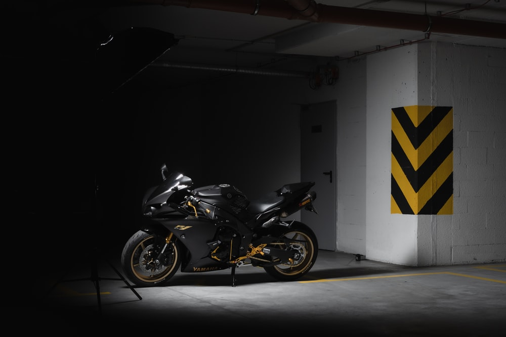 black and yellow naked motorcycle