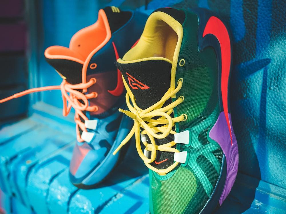 green and orange nike basketball shoes