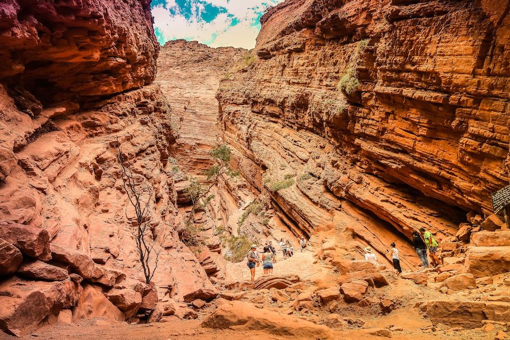 people walking on rocky mountain during daytime