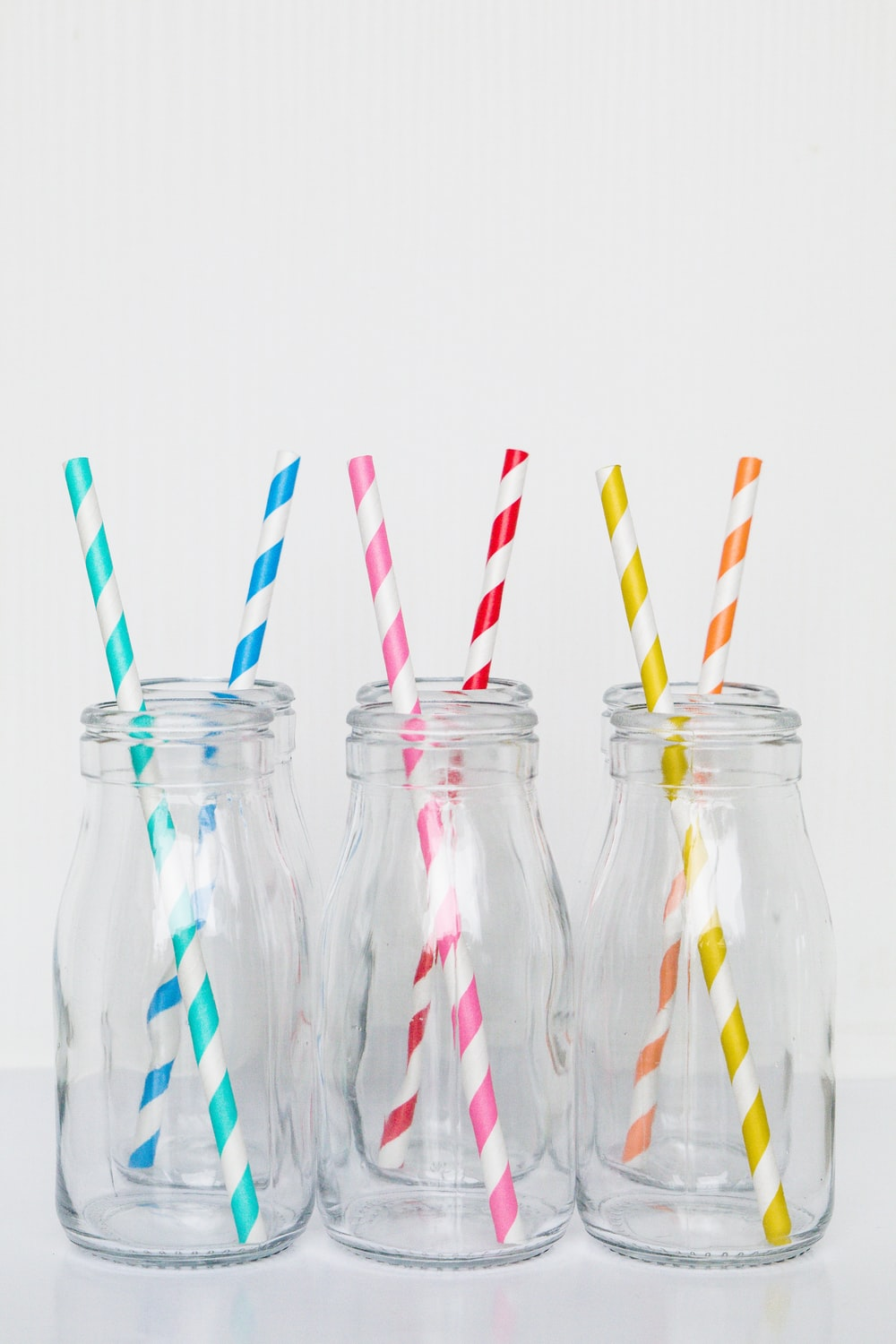 clear glass bottles with red white and blue stripe straw