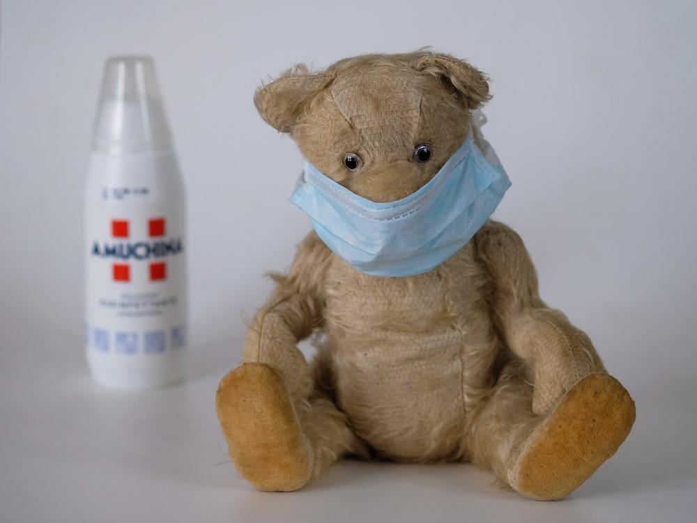 brown bear plush toy on white table