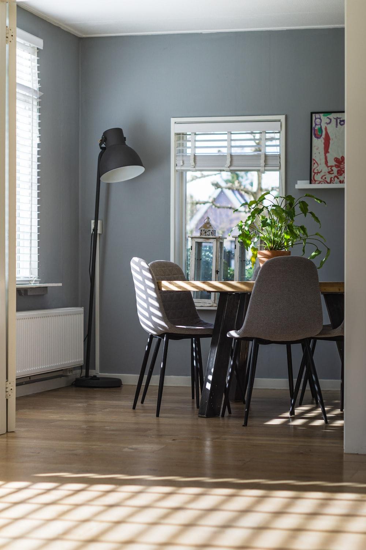 black and white floor lamp beside white window blinds