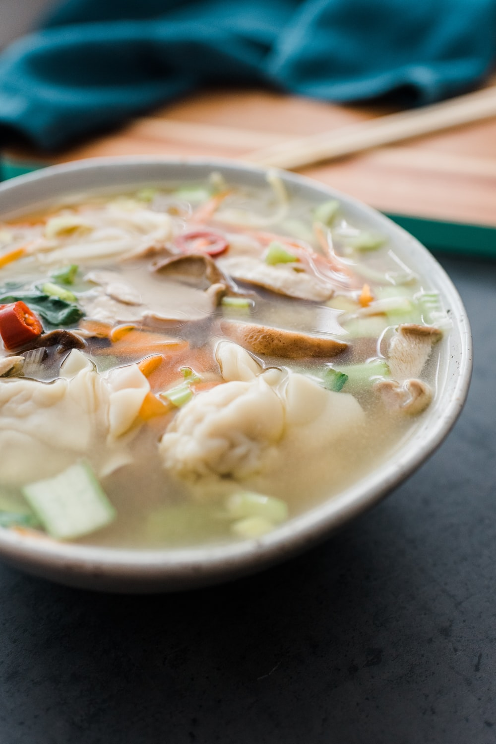 soup with meat and vegetables in white ceramic bowl