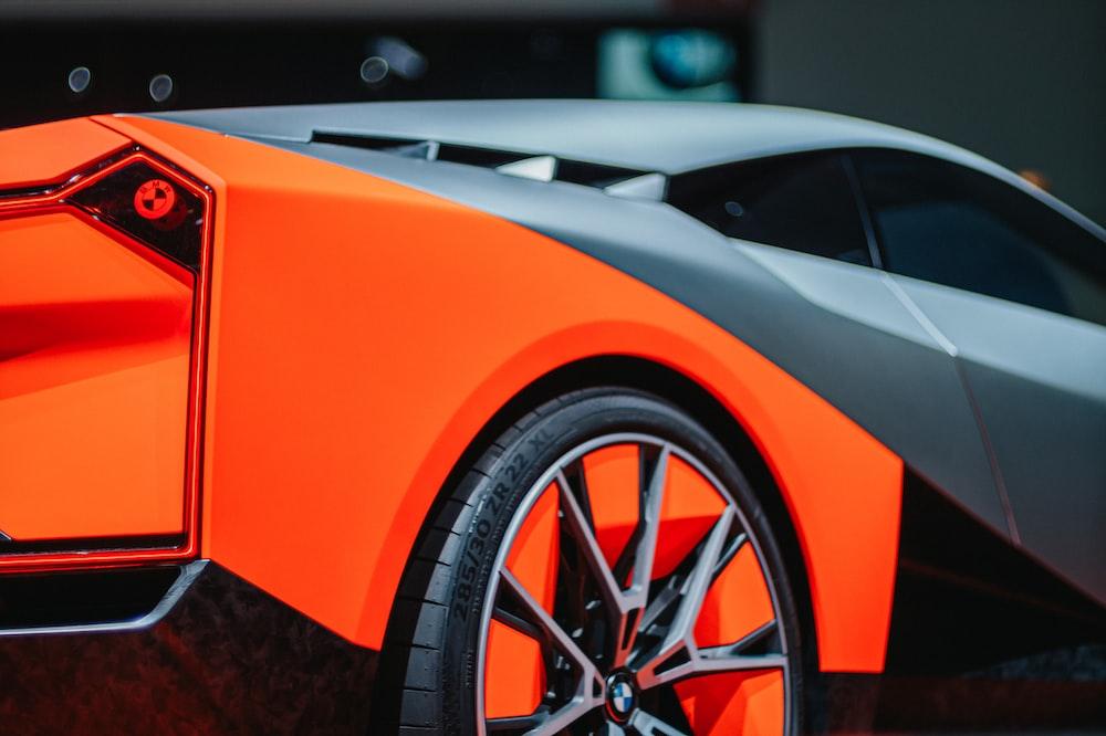 orange and black ferrari sports car